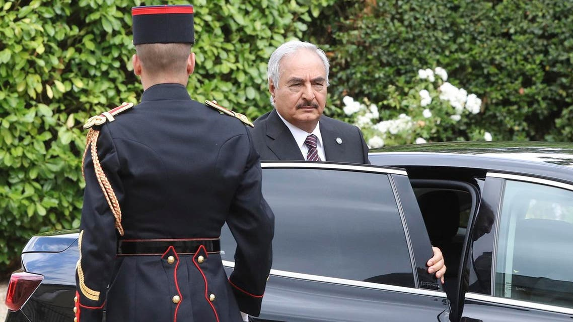 Khalifa Haftar, the military commander who controls the remote east of Libya, arrives in La Celle-Saint-Cloud, near Paris, for talks aimed at easing tensions in Libya, on July 25, 2017. AFP