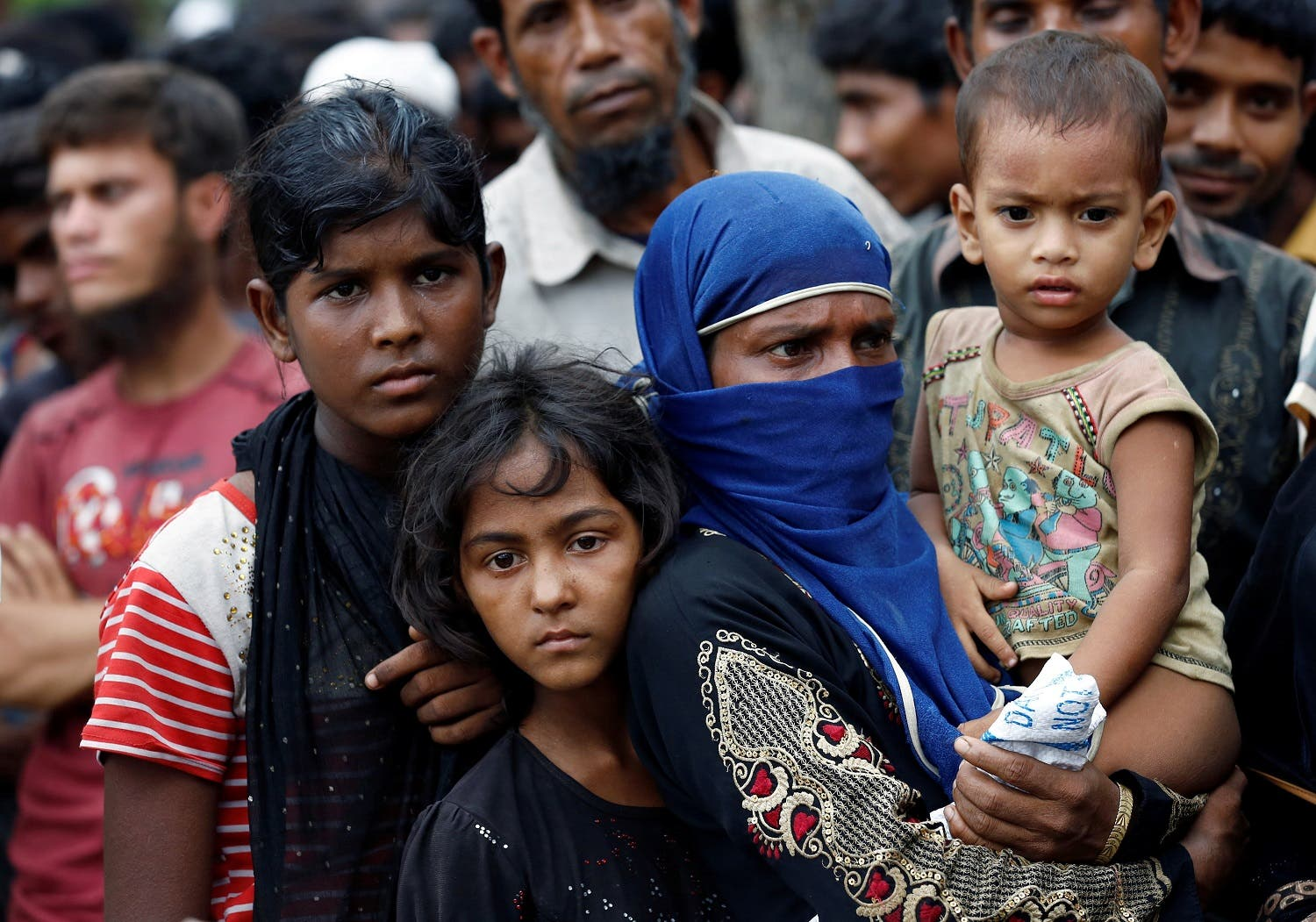 Rohingya refugees gather to collect relief supplies at the Balukhali Makeshift Refugee Camp as they are affected by Cyclone Mora in Cox's Bazar, Bangladesh May 31, 2017. REUTERS/Mohammad Ponir Hossain