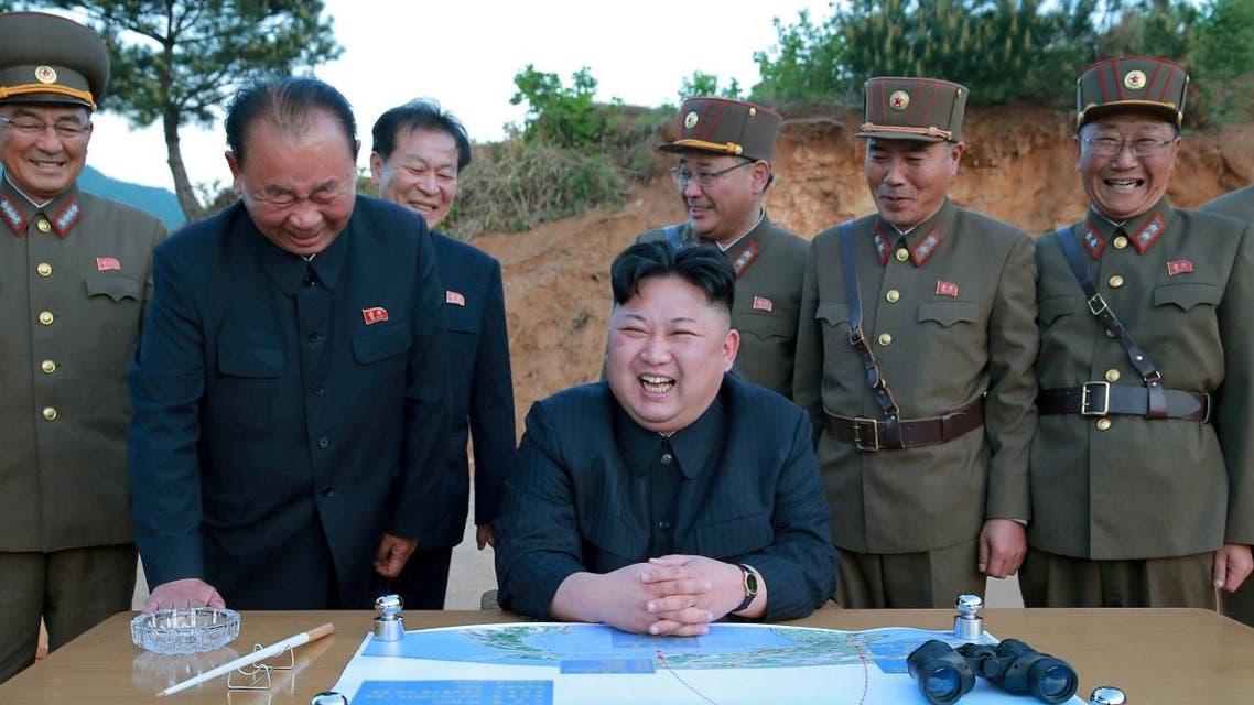 North Korean leader Kim Jong Un reacts during the long-range strategic ballistic rocket Hwasong-12 (Mars-12) test launch. (Reuters)