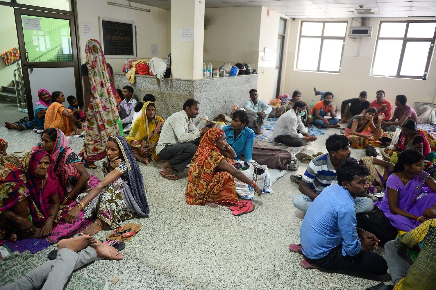 Relatives of patients wait outside the encephalitis ward at the Baba Raghav Das Hospital in Gorakhpur on August 14, 2017. (AFP)