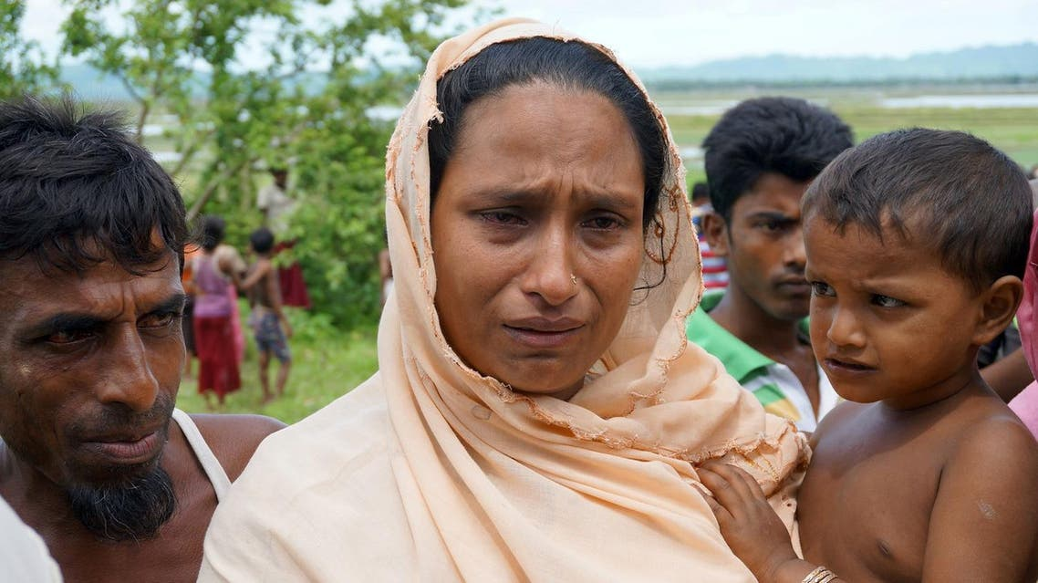 Sarbeda, whose teenage son was arrested for suspected links to a militant group, speaks to reporters in Kyar Gaung Taung village, northern Rakhine state, Myanmar July 14, 2017. Picture taken July 14, 2017. REUTERS/Simon Lewis