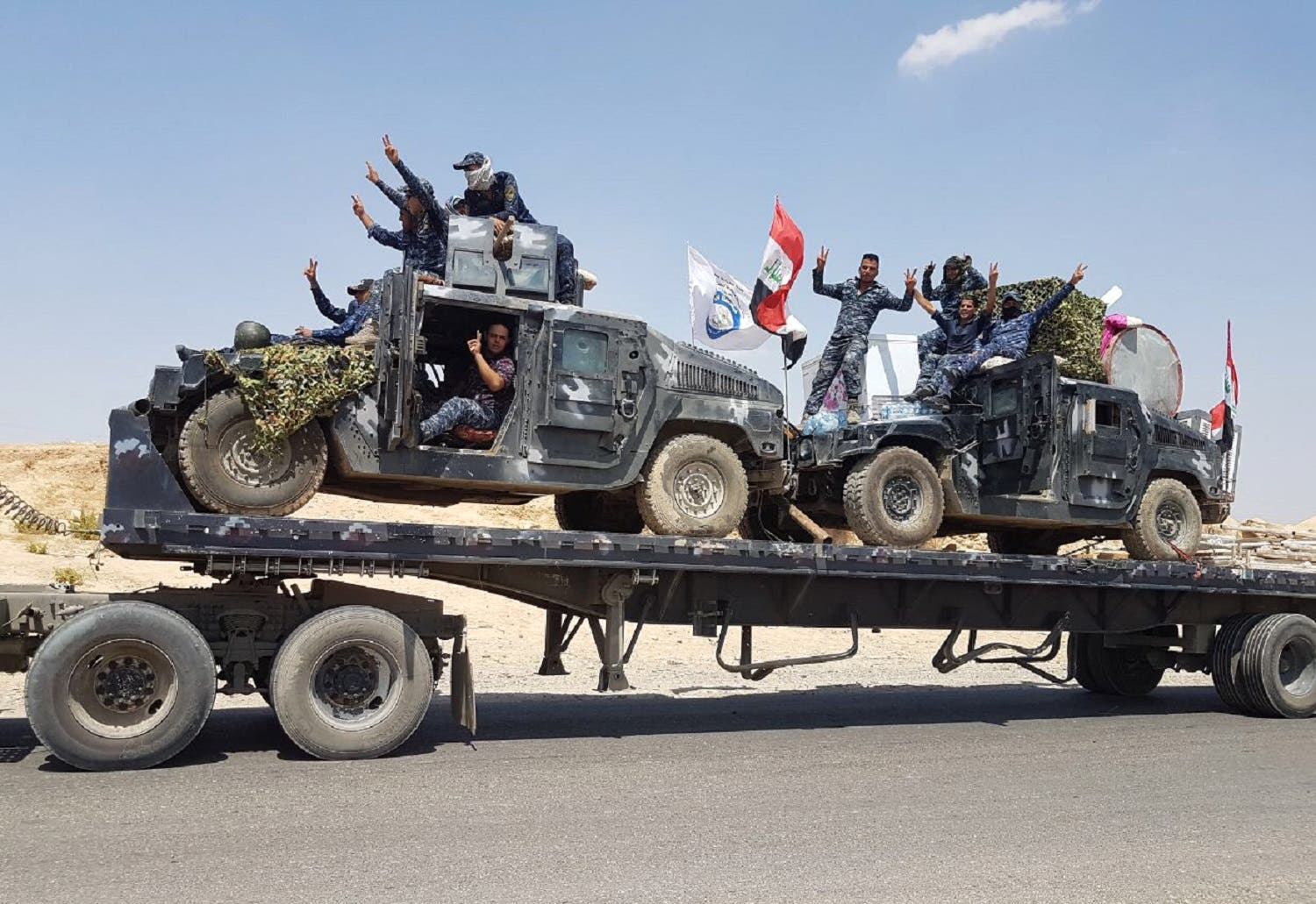 Iraqi armored units headed for Tal Afar, the main remaining ISIS group stronghold in the northern part of the country. (AFP)