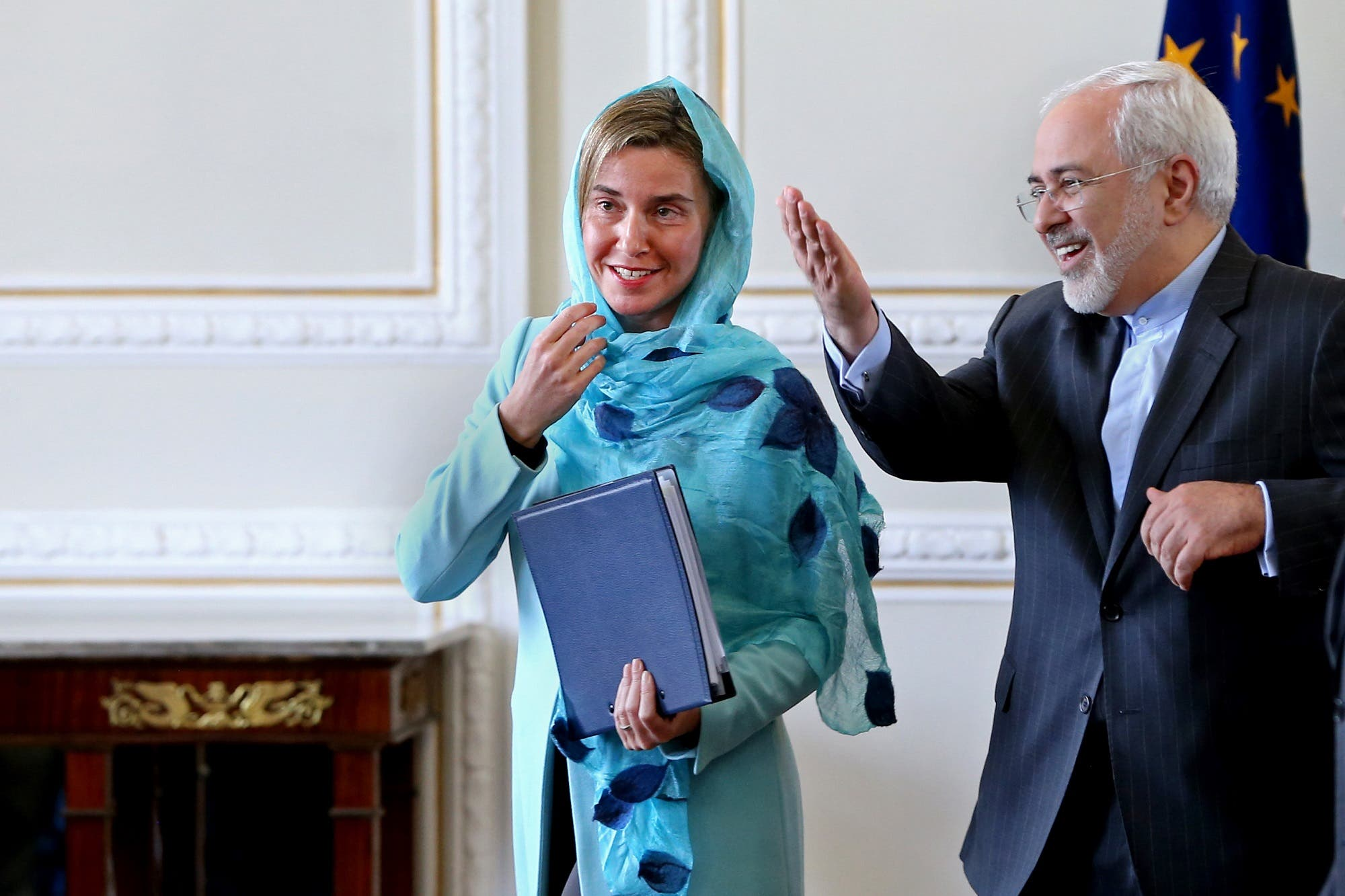 Foreign Minister Javad Zarif, right, gestures to EU foreign policy chief Federica Mogherini at the end of their press conference in Tehran, Iran, April 16, 2016. (AP)