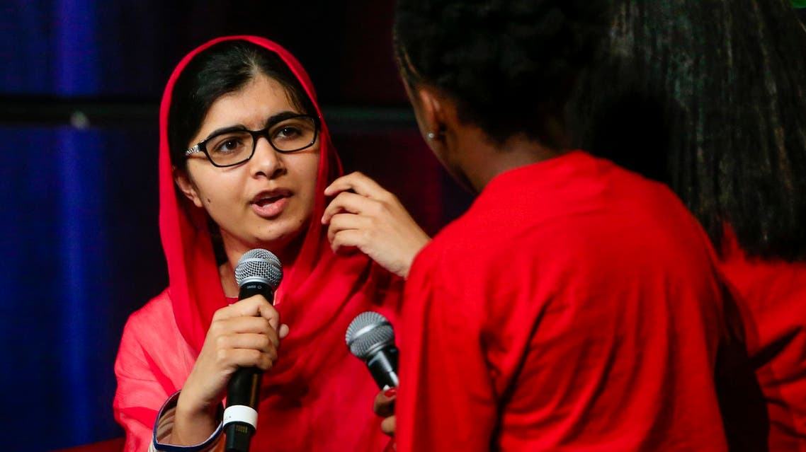 Malala Yousafzai chats with panelists on stage at a benefit lunch for Girls Inc. in Omaha, Neb., on July 18, 2016. (AP)