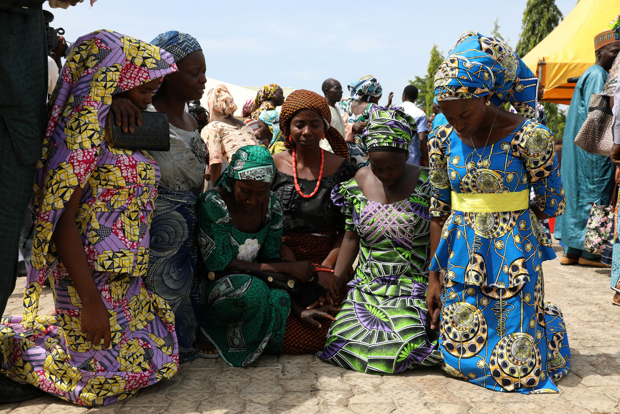 Newly released 82 Chibok school girls pray as they reunite with their families in Abuja, Nigeria May 20, 2017. REUTERS