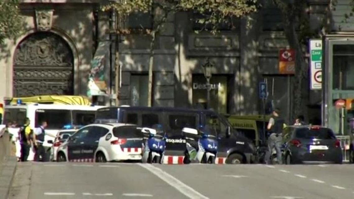 A still image from video shows a police cordon on a street in Barcelona, Spain following a van crash August 17, 2017.