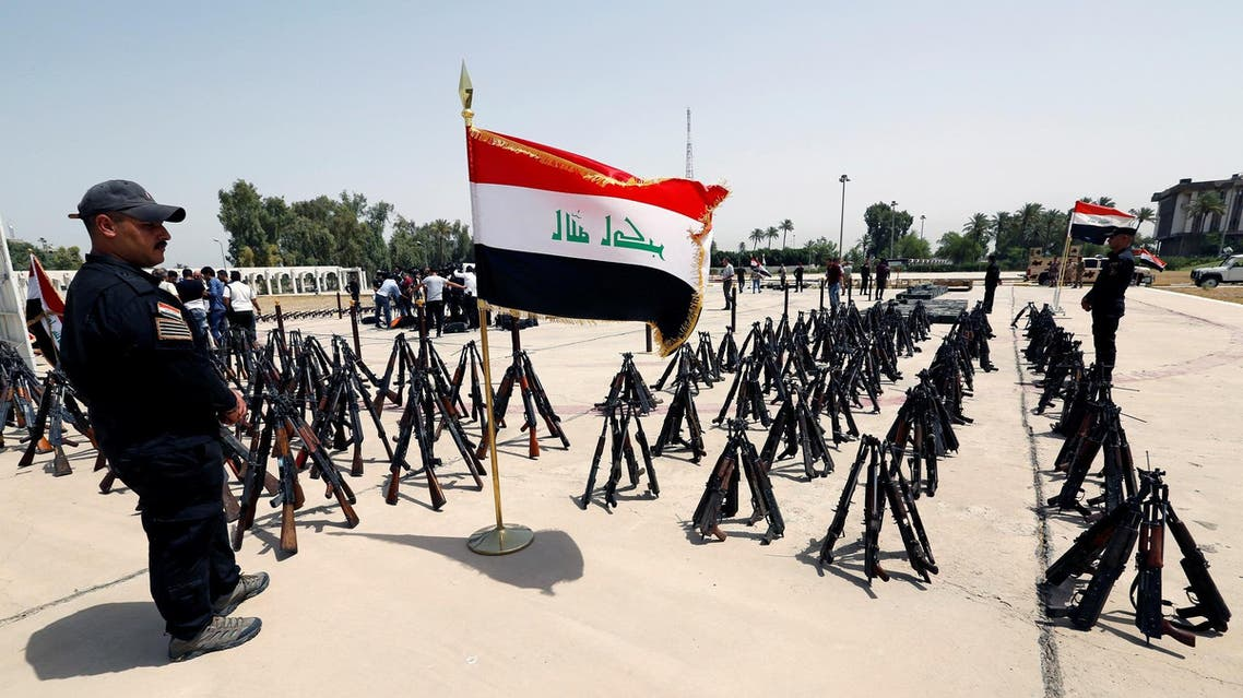 Iraqi security forces display assorted weapons that were confiscated from ISIS militants, at Iraqi military intelligence directorate in Baghdad, on August 9, 2017. (Reuters)