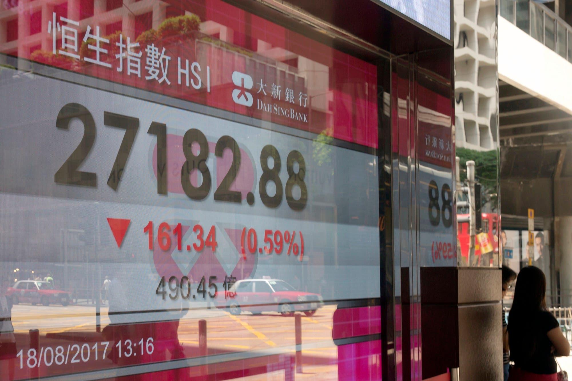An electronic stock board shows the Hang Seng Index at a bank in Hong Kong, Aug. 18, 2017. (AP)