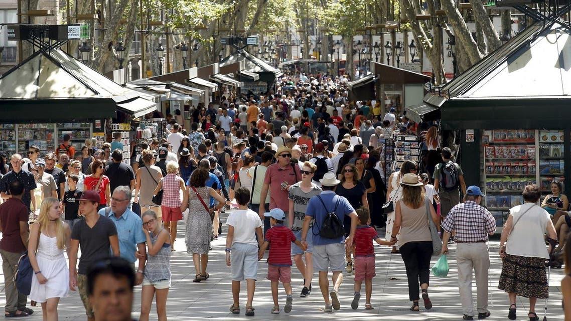 People walk by Las Ramblas in Barcelona, Spain. Reuters