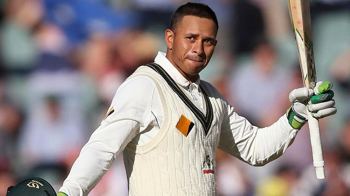 Australia's Usman Khawaja celebrates making 100 runs against South Africa during their cricket test match in Adelaide. (AP)
