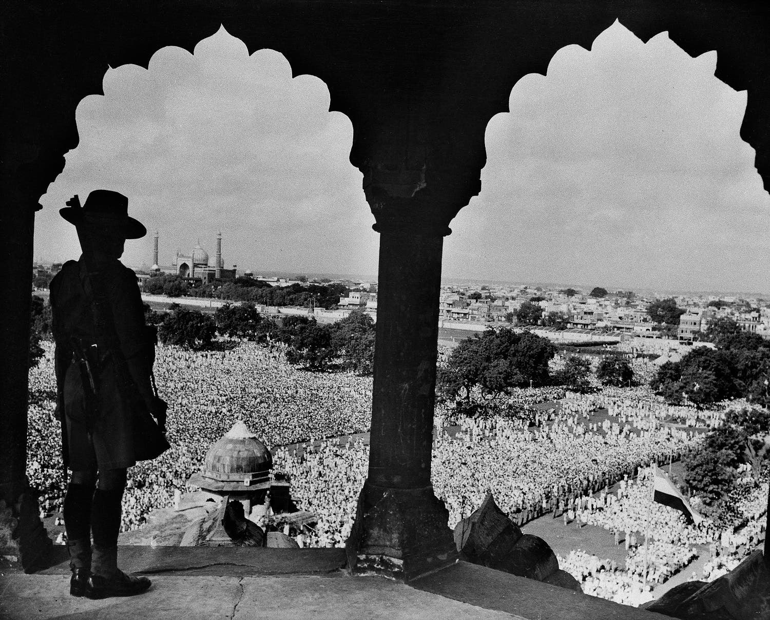 In this Aug. 15, 1948 file photo, an armed Gurkha towers over thousands Indians in a courtyard beneath the Red Fort celebrating the first anniversary of India's independence, in New Delhi. (AP)
