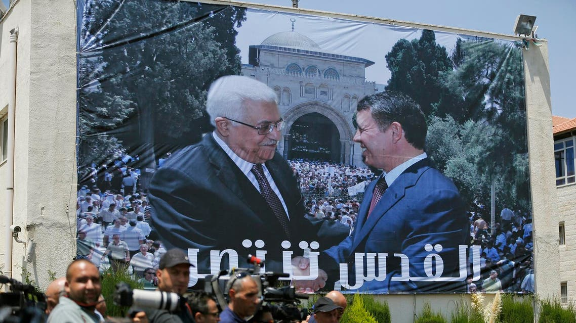 A photo of Jordan's King Abdullah II and Palestinian president Mahmud Abbas shaking hands in front of the Al-Aqsa mosque during a welcome ceremony of the King in Ramallah on August 7. (AFP)