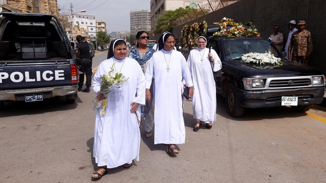 Nuns walk with flowers to attend the funeral of the German-born Sister Dr. Ruth Pfau, outside the St. Patrick's Cathedral in Karachi, Pakistan August 19, 2017. (Reuters)