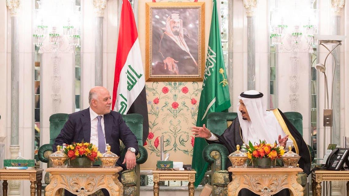 Saudi King Salman bin Abdulaziz (R) meeting with Iraqi Prime Minister Haidar al-Abadi in Mecca, June 19, 2017. (AFP).