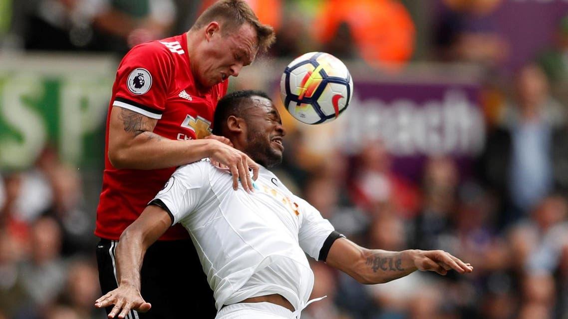 Manchester United's Phil Jones in action with Swansea City's Jordan Ayew. ( Reuters)