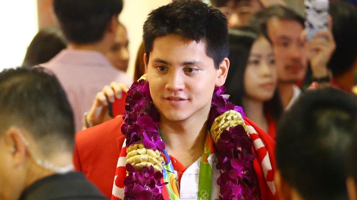Singaporean swimmer Joseph Schooling on his arrival at the Singapore Changi Airport on August 15, 2016. (AP)