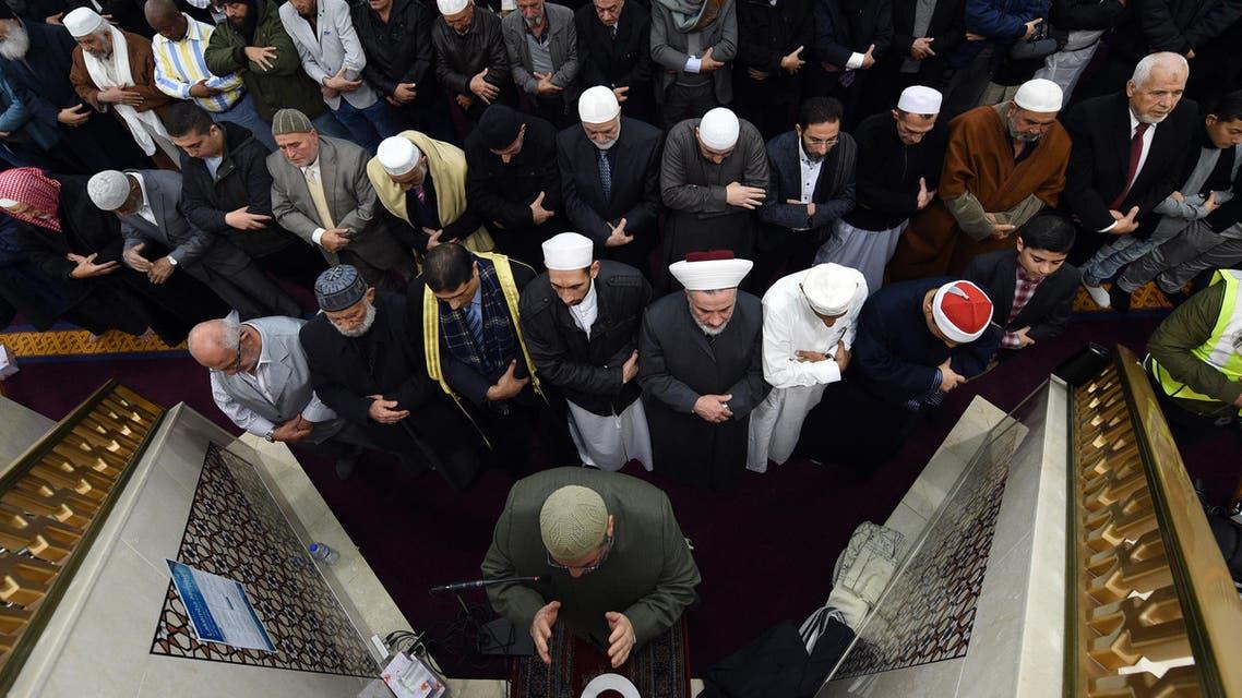 Sheikh Yahya Safi (bottom C), imam of the Lekamba mosque, leads an Eid al-Fitr prayer at the Lekamba mosque in western Sydney on June 25, 2017. (AFP)