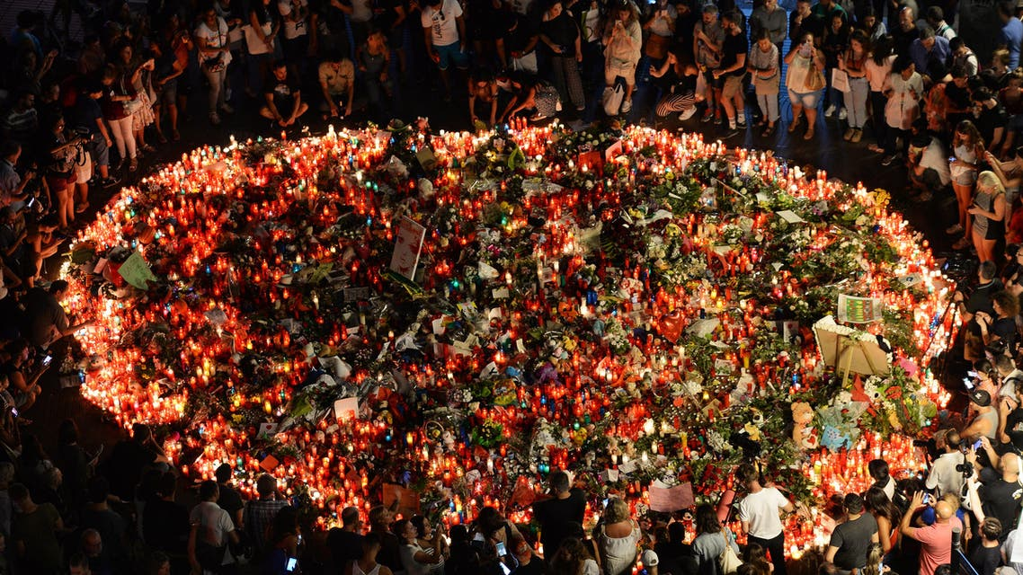 People pay tribute to the victims of the Barcelona attack on Las Ramblas boulevard in Barcelona on August 19, 2017. (AFP)