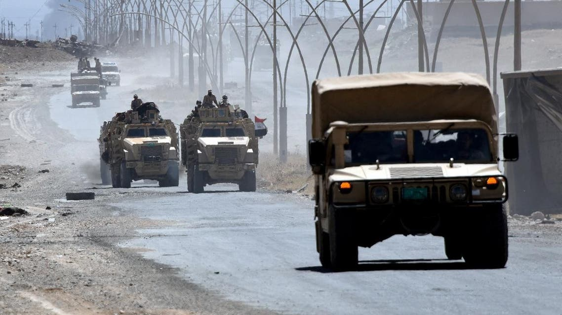 Iraqi government forces drive on a road leading to Tal Afar on June 9, 2017, during ongoing battles to retake the city from ISIS. (File photo: AFP)