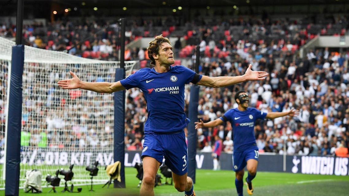 Chelsea's Spanish defender Marcos Alonso (L) celebrates scoring their second goal with Chelsea's Spanish midfielder Pedro (R) during the English Premier League football match between Tottenham Hotspur and Chelsea at Wembley Stadium in London, on August 20, 2017. (AFP)