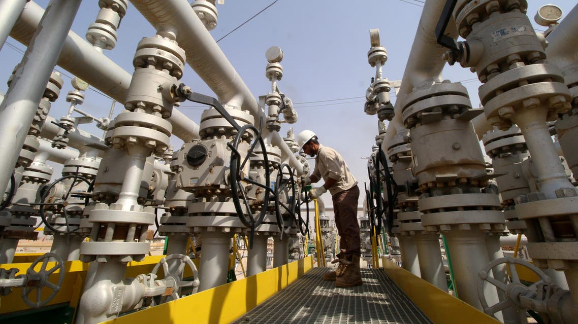 A worker adjusts a valve of an oil pipe in Zubair oilfield in Basra, Iraq July 20, 2017. REUTERS