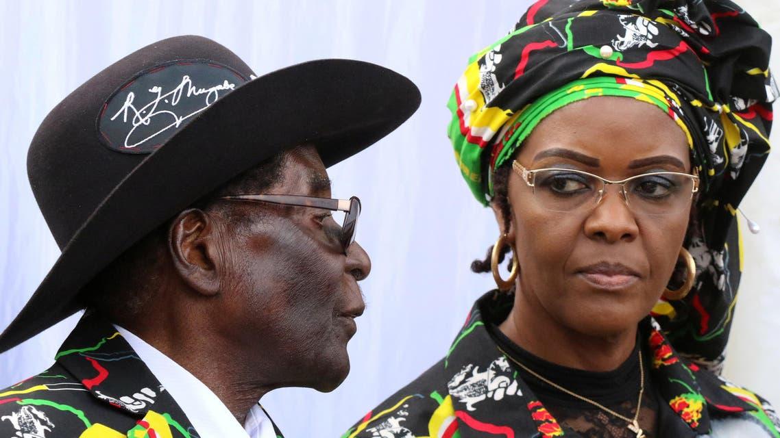 President Robert Mugabe and his wife Grace attend a rally of his ruling ZANU (PF) in Chinhoyi, Zimbabwe, July 29, 2017. (Reuters)