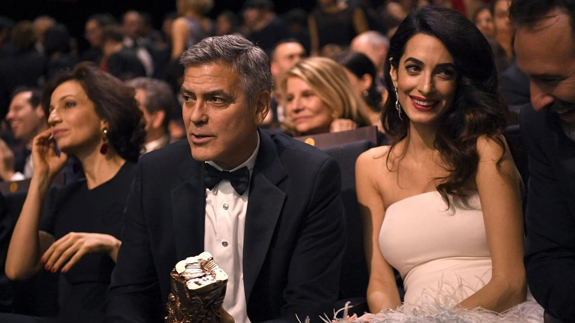(LtoR) French Culture Minister Audrey Azoulay, US actor George Clooney, British-Lebanese lawyer Amal Clooney and French actor Jean Dujardin attend the 42nd edition of the Cesar Ceremony at the Salle Pleyel in Paris on February 24, 2017. (AFP)