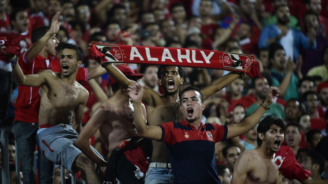 Fans of Egypt's Al Ahly cheer on their team during their African Champions League (CAF) group stage football match with Cameroon's Cotonsport, at Borg el-Arab Stadium near Alexandria on July 8, 2017. (AFP)