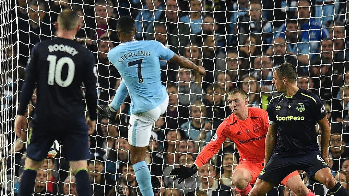 Manchester City's English midfielder Raheem Sterling (2L) scores his team's first goal during the English Premier League football match between Manchester City and Everton at the Etihad Stadium in Manchester, north west England, on August 21, 2017. (AFP)