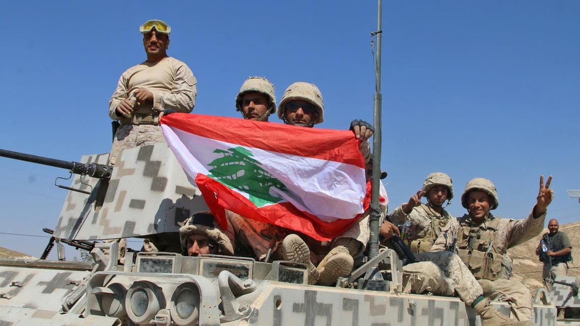 Lebanese army soldiers sit a top an armoured personnel carrier (APC) as they drive in the eastern town of Ras Baalbek, on August 21, 2017, upon returning from the mountainous frontline where an offensive against the Islamic State group on the country's eastern border with Syria after capturing a third of the territory IS held in the region. (AFP)