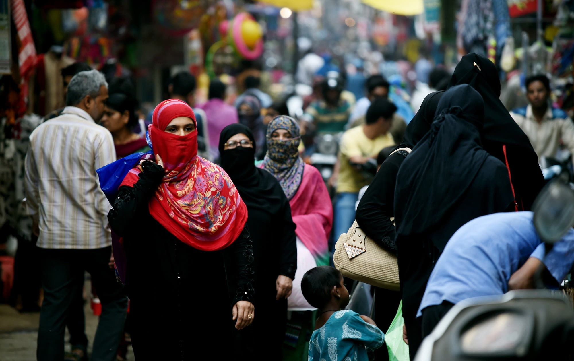 In this photograph taken on April 28, 2016, Muslim shoppers walk through a market in Bhopal. (AFP)