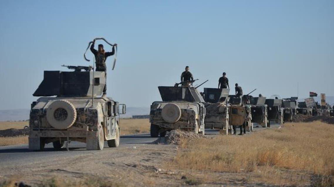ميليشيا الحشد الشعبي مع أفراد من الجيش العراقي على مشارف تلعفر يوم 20 أغسطس آب 2017