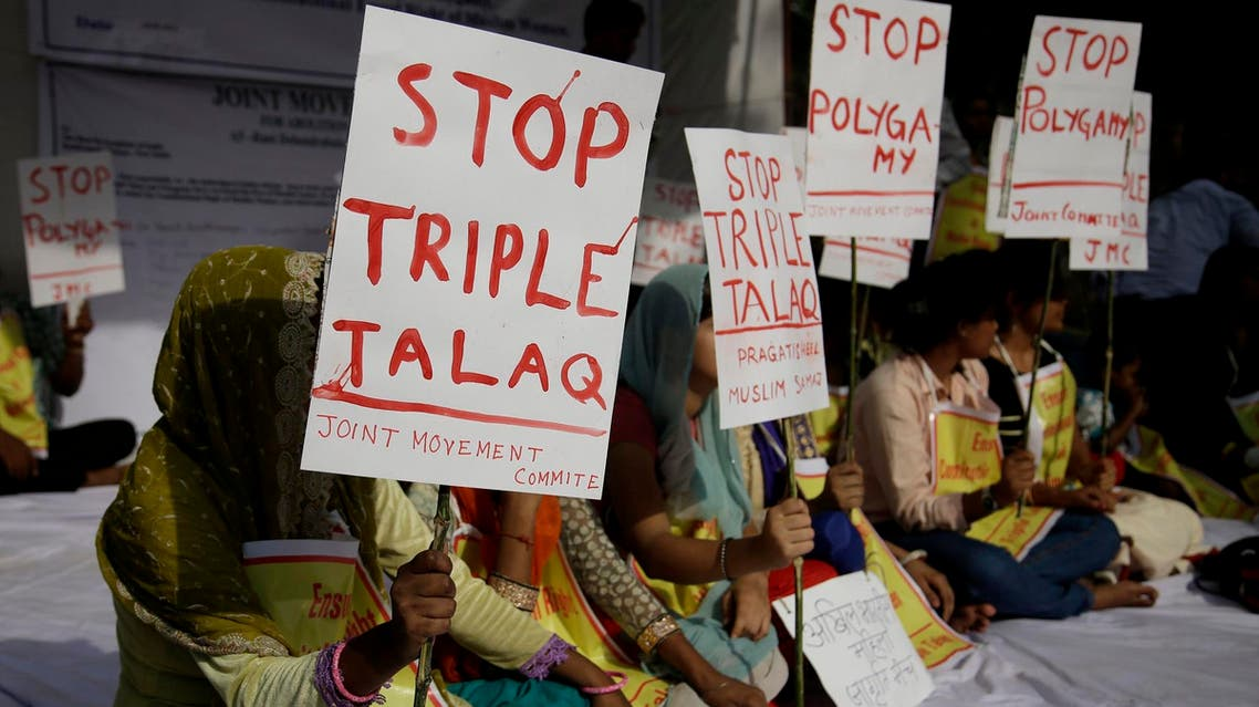 """Activists of various social organizations hold placards during a protest against """"Triple Talaq"""", in New Delhi, India, on May 10, 2017. (AP)"""
