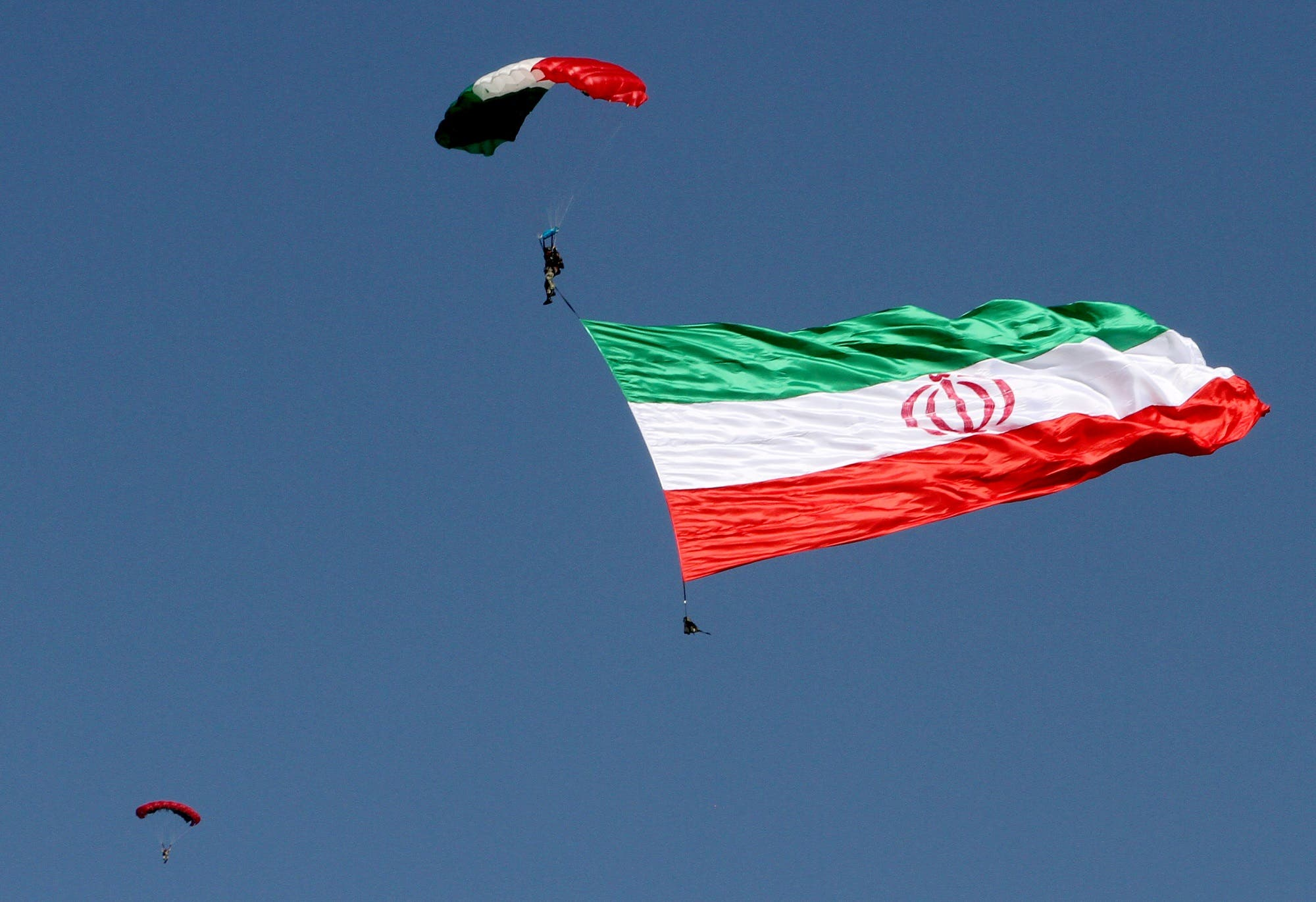 Iranian paratroopers perform during a parade marking the country's Army Day, on April 18, 2017, in Tehran. (AFP)