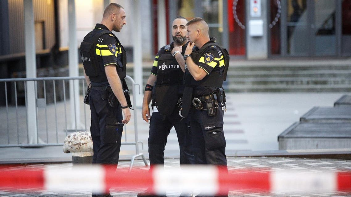 Police stand during the evacuation the Maassilo concert venue after a concert by Californian ban Allah-Las was canceled in relation to a terror attack threat, according to police and the venue, on August 23, 2017, in Rotterdam. (AFP)