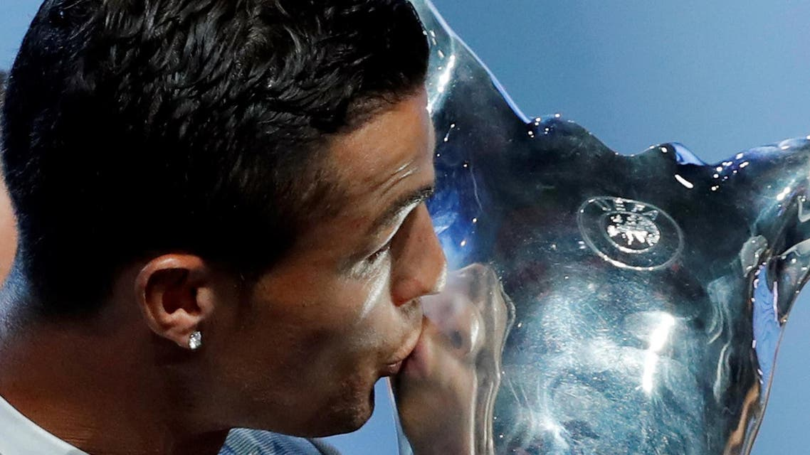 Real Madrid's Cristiano Ronaldo kisses the trophy after winning the UEFA Men's Player of the Year award. (Reuters)