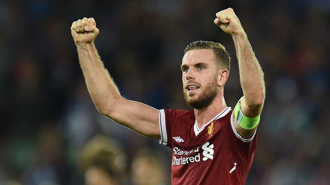 Liverpool's English captain Jordan Henderson celebrates victory after the Champions League qualifier, second leg match between Liverpool and Hoffenheim at Anfield stadium in Liverpool on August 23, 2017. (AFP)