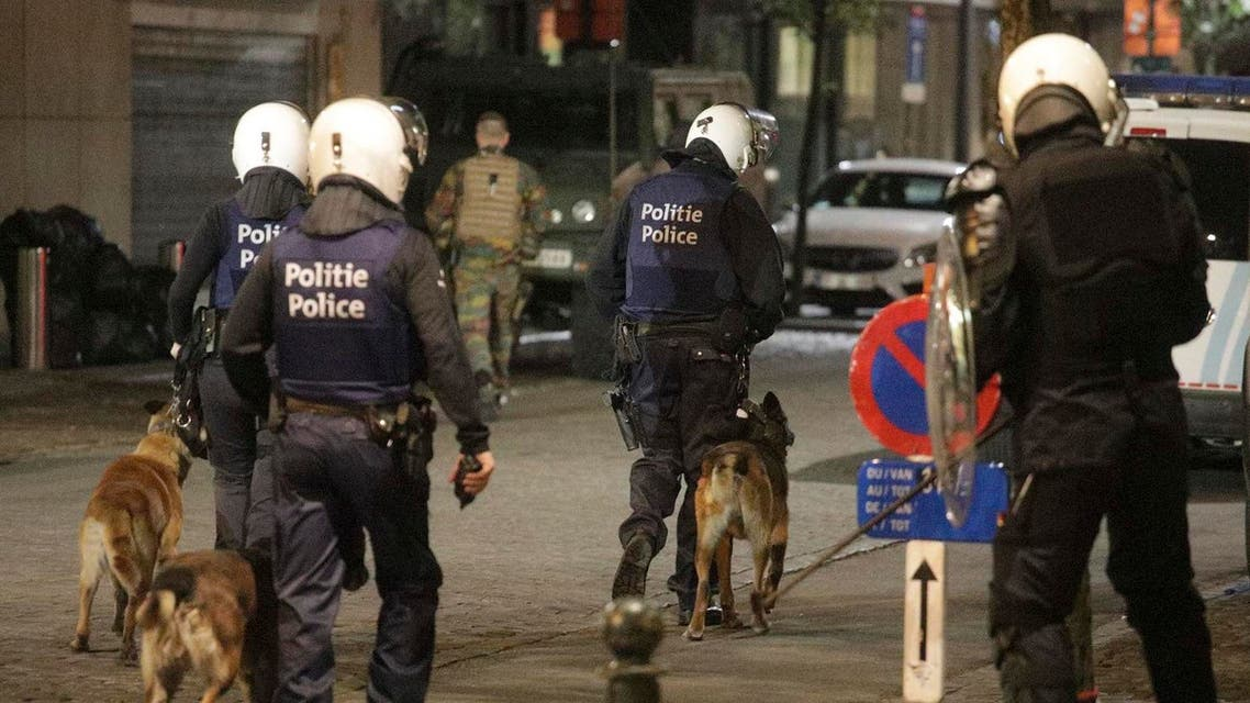 Belgian police with dogs and Belgian Army soldiers. (AP)