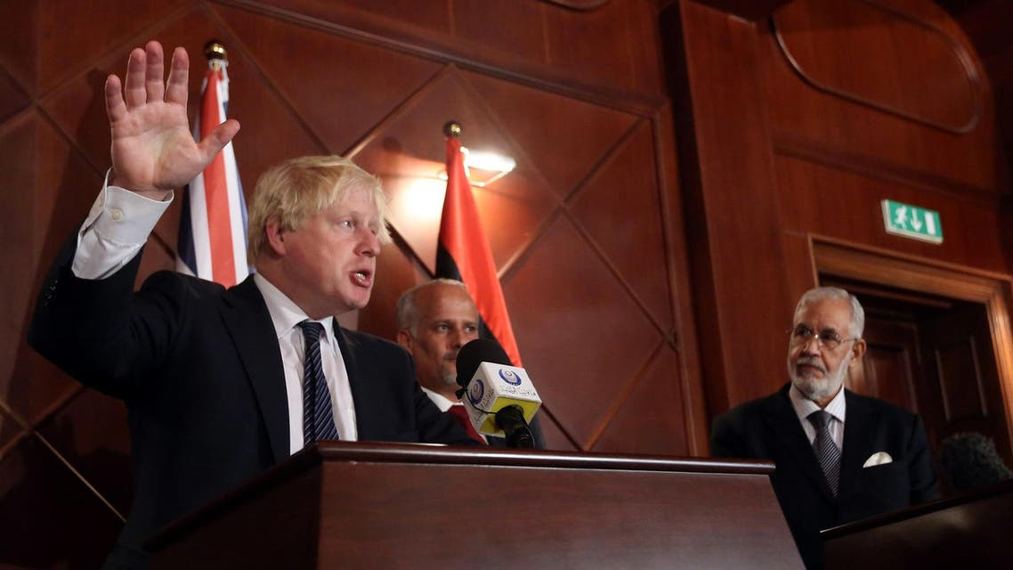 Boris Johnson speaks during a press conference with Mohamed al-Taher Siala (R), Foreign Minister of the UN-backed Libyan Government of National Accord, in Tripoli on August 23, 2017. (AFP)