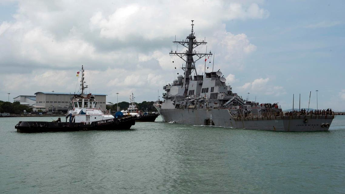 Tugboats from Singapore assist the Guided-missile destroyer USS John S. McCain following a collision with the merchant vessel east of the Straits of Malacca and Singapore. (AP)