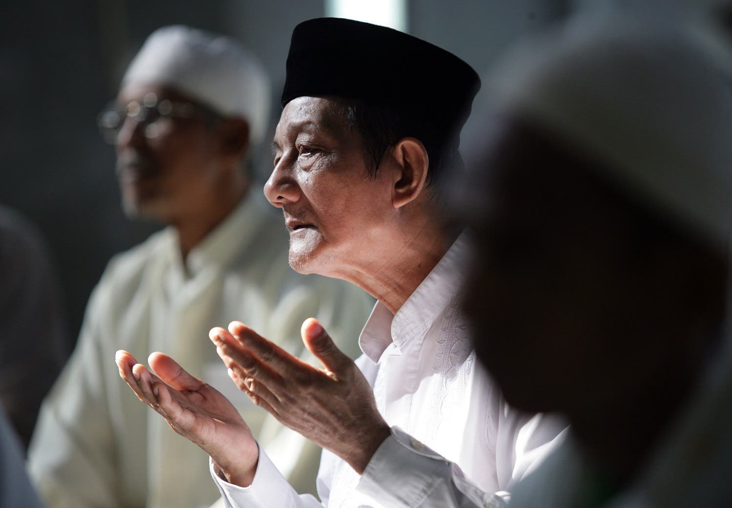 A group of Indonesian Muslims hold a mass prayer at a mosque in Jakarta on July 12, 2009 in support of Muslim Uighurs, following the recent deadly rioting which left more than 180 people dead in China's Xinjiang region. (AFP)