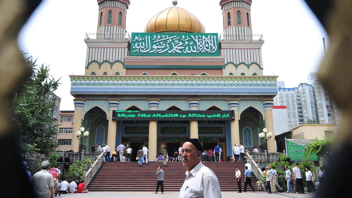 Uighur Muslims arrive for Friday prayers at the Yanhan Mosque in Urumqi on July 17, 2009 in northwest China's Xinjiang province. (AFP)