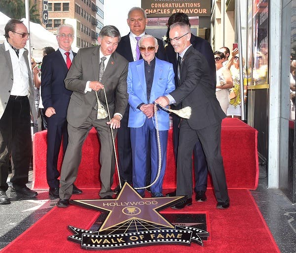 Charles Aznavour (C) attends his Hollywood Walk of Fame Star ceremony. (AFP)