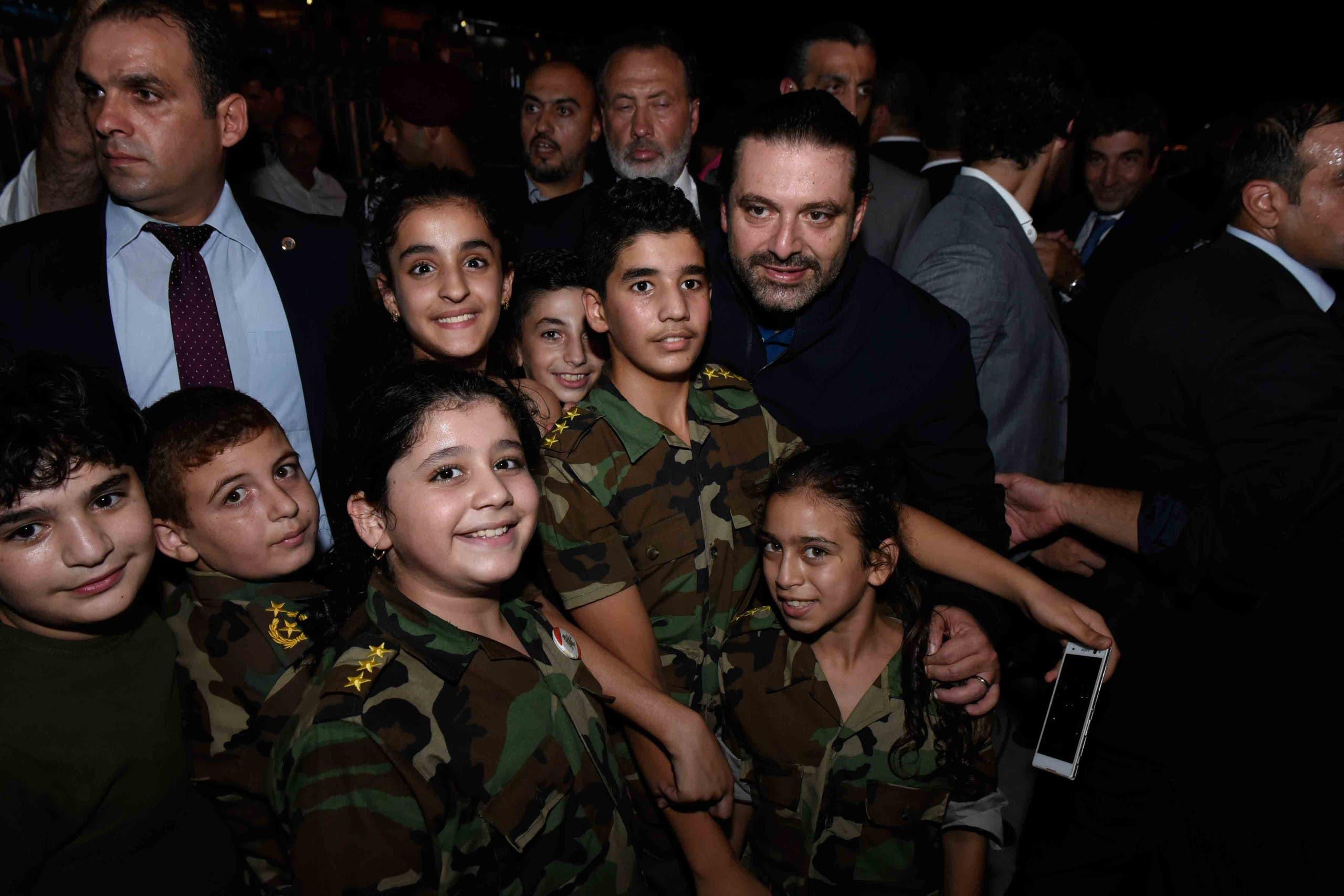 الرئيس سعد الحريري برفقة أولاد شهداء الجيش اللبناني الذين شاركوا بهذه المناسبة من خلال تأدية نشيد خاص