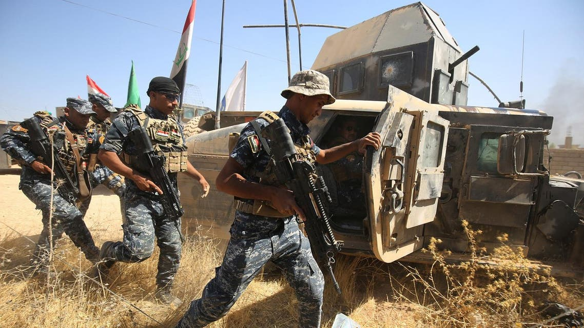 Members of the Iraqi forces advance through Tal Afar on August 24, 2017. (AFP)