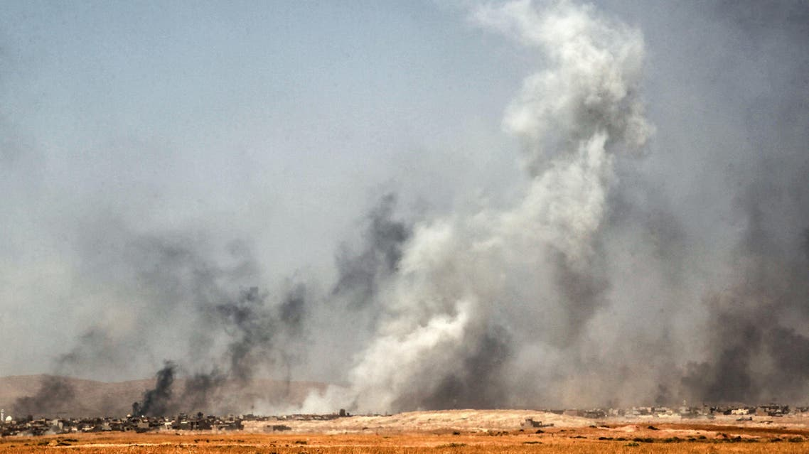 Smoke billows as Iraqi forces, backed by the Hashed al-Shaabi (Popular Mobilisation units), advance inside the town of Tal Afar, west of Mosul. (AFP)