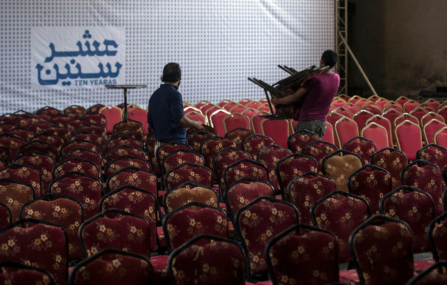 Palestinian workers prepare the hall for the screening of '10 Years' at Samer Cinema in Gaza City on August 26, 2017. (AFP)