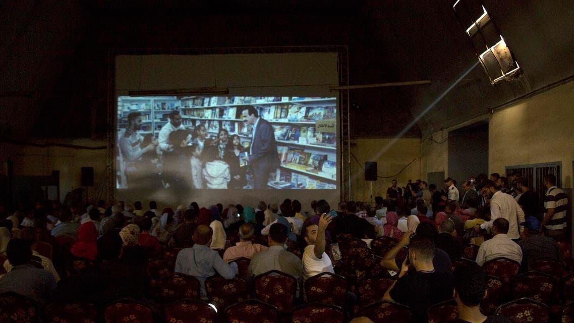 Palestinians attend the screening of '10 Years' at Samer Cinema in Gaza City on August 26, 2017. (AFP)
