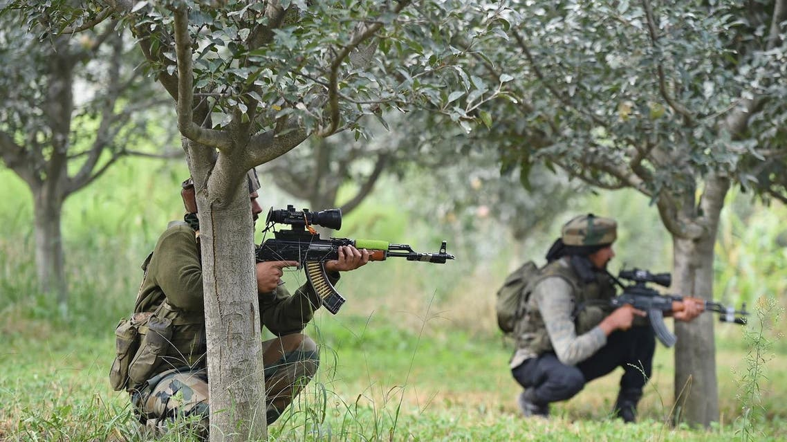Indian soldiers takes positions in an apple orchard while a gunfight takes place between militants and government forces in Pulwama, south of Srinagar, on August 26, 2017. (AFP)