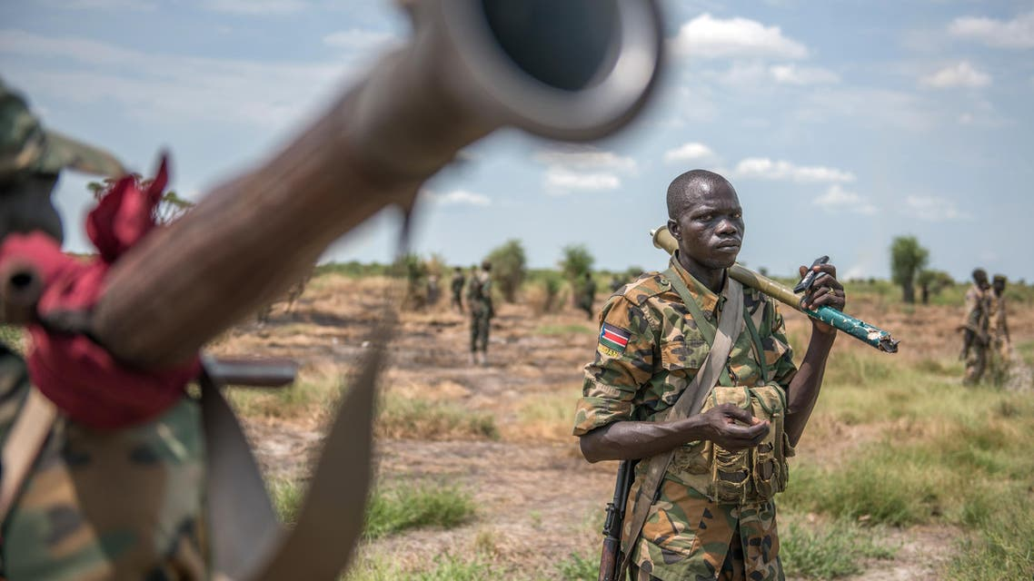 Sudan People Liberation Army (SPLA) soldiers patrol in Alole, northern South Sudan, on October 16, 2016. AFP